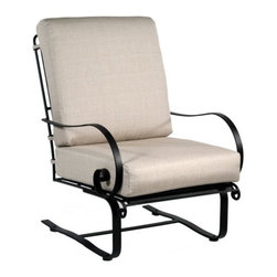 O.W. Lee Avalon Wrought Iron Spring Club Chair - In spring, fall, or any season, the O.W. Lee Avalon Spring Club Chair offers an unmatched combination of comfort and style, built to last for years and years. Part of the Avalon Collection, the club chair features details like spiraled arms and hand-crafted wrought iron construction for guaranteed durability. Plus, the micro mesh material provides comfort in the seat and back with added spring support. The chair also features a fade-resistant Sunbrella cushion in your choice of several attractive color options. Weight: 66 pounds. Dimensions: 27.5W x 33D x 38H inches. Materials and construction:Only the highest quality materials are used in the production of O.W. Lee Company's furniture. Carbon steel, galvanized steel, and 6061 alloy aluminum is meticulously chosen for superior strength as well as rust and corrosion resistance. All materials are individually measured and precision cut to ensure a smooth, and accurate fit. Steel and aluminum pieces are bent into perfect shapes, then hand-forged with a hammer and anvil, a process unchanged since blacksmiths in the middle ages. For the optimum strength of each piece, a full-circumference weld is applied wherever metal components intersect. This type of weld works to eliminate the possibility of moisture making its way into tube interiors or in a crevasse. The full-circumference weld guards against rust and corrosion. Finally, all welds are ground and sanded to create a seamless transition from one component to another. Each frame is blasted with tiny steel particles to remove dirt and oil from the manufacturing process, which is then followed by a 5-step wash and chemical treatment, resulting in the best possible surface for the final finish. A hand-applied zinc-rich epoxy primer is used to create a protective undercoat against oxidation. This prohibits rust from spreading and helps protect the final finish. Finally, a durable polyurethane top coating is hand-applied, and oven-cured to ensure a long lasting finish. About SunbrellaSunbrella has been the leader in performance fabrics for over 45 years. Impeccable quality, sophisticated styling and best-in-class warranties prove the new generation of Sunbrella offers more possibilities than ever. Sunbrella fabrics are breathable and water-repellant. If kept dry, they will not support the growth of mildew as natural fibers will. Beautiful and durable, Sunbrella is a name you can trust in your outdoor furniture. Cleaning and Caring for SunbrellaRegular maintenance is the best way to keep your Sunbrella fabrics looking good and delay deep, vigorous cleaning. Brush off dirt before it becomes embedded in the fabrics, and wipe up spills as soon as they occur. For light cleaning, use a mild soap and water solution and a sponge, allowing your cleaning solution to soak into the fabric. Rinse thoroughly to remove all soap residue and allow fabric to air dry. About O.W. Lee CompanyAn American family tradition, O.W. Lee Company has been dedicated to the design and production of fine, handcrafted casual furniture for over 60 years. From their manufacturing facility in Ontario, California, the O.W. Lee artisans combine centuries-old techniques with state-of-the-art equipment to produce beautiful casual furniture. What started in 1947 as a wrought-iron gate manufacturer for the luxurious estates of Southern California has evolved, three generations later, into a well-known and reputable manufacturer in the ever-growing casual furniture industry.