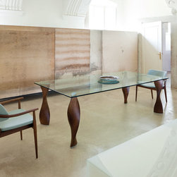 Porada Wood Furnishings - The Four table by Porada is a rectangular dining-table with legs available in solid canaletta walnut or ash and 15mm thick glass top.