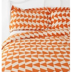 Magical Thinking Arrowhead Duvet Cover, Orange - Fun triangles make up a tribal theme that is ultra versatile for the fall. Of course, you could interpret these as candy corns too.