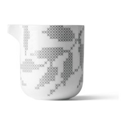 MENU - Gray Leaves Milk Jug - Milk may not be delivered to your doorstep, but you can still serve it up in style. This porcelain milk jug features a traditional cross-stitch leaf pattern that was designed by Danish ceramist, Gry Fager. Don't settle for the old plastic container anymore — add some panache to your morning routine.