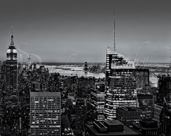 Manhattan Sunset BW - A black and white view to the New York City skyline from Top of The Rock at Rockefeller Center in New York City.