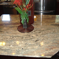 Problem Areas Make Creative Solutions - The customers choose a beautiful Crema Bordeaux granite top to tie in the rich deep cranberry finish of the cabinets.  The deep burgundy veining in this top is one of their favorite features of the kitchen.  It shows some more of mother nature's great characteristics.