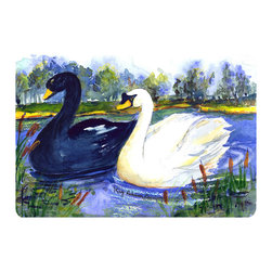 Caroline's Treasures - Bird - Swan Kitchen or Bath Mat 20 x 30 - Kitchen or Bath Comfort Floor Mat This mat is 20 inch by 30 inch. Comfort Mat / Carpet / Rug that is Made and Printed in the USA. A foam cushion is attached to the bottom of the mat for comfort when standing. The mat has been permanently dyed for moderate traffic. Durable and fade resistant. The back of the mat is rubber backed to keep the mat from slipping on a smooth floor. Use pressure and water from garden hose or power washer to clean the mat. Vacuuming only with the hard wood floor setting, as to not pull up the knap of the felt. Avoid soap or cleaner that produces suds when cleaning. It will be difficult to get the suds out of the mat.