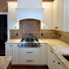 Mediterranean Kitchen Cabinets by Vella Bath & Kitchen, Inc.