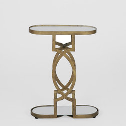 Natasha Table - With a mirrored top and shelf and a brass antique geometric metal frame, this petite oval drink table is very versatile. Perfect to put next to your favorite chair, this dynamic occasional piece is just the right size for your favorite beverage and your cell phone.