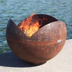 Frontgate - Firefly Sculptural Firebowl - The artistically created shape accentuates the shadow and flame as it shifts inside the bowl. Each fire bowl arrives with a signed stainless steel authenticity plate. Natural rust patina will continue to weather over time or you can paint your firebowl; view instructions. Can be left outdoors year-round. Maintenance free and crafted to last for generations. Scalloped edges give the Firefly Sculptural Bowl the unique shape of a seed or flower pod. Ideal for use near the beach or in other breezy areas, the petal-shaped sides shield the flames from the wind. This one-of-a-kind piece is handcrafted from 100% recycled, American-made steel that has been hand cut and smoothed by artist John T. Unger. . .  .  . . Attached base provides a stable display. Suitable for use with wood or charcoal . View safety instructions (PDF format). Made in the USA.