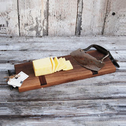 Walnut Made-To-Order Cheese Board - Each Walnut Made-To-Order Cheese Board has been hand rubbed with olive oil, requires little maintenance, and is individual to the wood it's made from.  Whether you're hosting brunch for friends or having a romantic dinner, this cutting and serving board's handles are aged-steel boat cleats and can be used for almost all occasions.