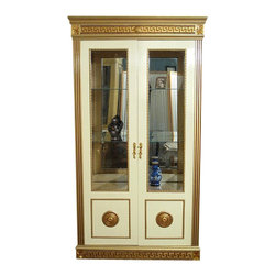 MBW Furniture - Neo Classical Cream & Gold China Curio Display Cabinet - This is a gorgeous Neo Classical cream & golden china curio cabinet. It has a gorgeous golden beveled top beautifully adorned with Greek key carved patterns and floral motifs and it features a spacious cabinet that has a luxurious mirrored back, 3 shelves, 2 of glass removable that have 2 golden elegant removable supports, a convenient drawer with dovetail joinery that has a beautiful front also adorned with Greek key carvings, beads, and lovely pulls, and there is also an additional cabinet at the bottom. This piece has 2 gorgeous doors with glass panels beautifully adorned with golden rope accents and distinguished round designs with Greek key and floral motifs. They also have decorative rope trim inside and lock with 1 key present. Both doors have brass key plates but only one has the actual keyhole. From its overall beauty to quality build this extravagant piece of furniture will not only enrich your current home decor with its opulence but it will also provide you a lifetime worth of luxury and pleasure.