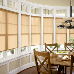 Designer Roller Screen Shades - Saint Charles - These kitchen windows really pop with Hunter Douglas® Designer Screen Shades. They help bring in the natural colors off the hardwood floors and dining room table.