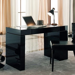 Nightfly Writing/Laptop Desk - Black - A perfect workstation for the multi-tasker or artist in your family the Nightfly Writing/Laptop Desk – Black is a perfect fit for any sort of room. This is a comfortable and stylish workstation sure to impress all who come upon it. Fine Italian craftsmanship and the sleekest modern materials give this piece its character. Finished in high-gloss black the bulk of the desk is solid wood accented by the faux-crocodile Eco-leather – just as handsome as the real article but environmentally friendly. Pens pencils notes and other essentials all have a place in the top storage pockets while the base itself houses a hidden drawer. Minimal assembly is required. Rossetto guarantees this product with a one-year manufacturer's warranty.About Rossetto USARossetto USA is the U.S. division of the Arros Group a leading manufacturer that exports Italian furniture style and design all over the world. Operating out of its warehouse in High Point N.C. since 1999 Rossetto provides complete contemporary and modern dining bedroom and occasional furniture programs that combine affordable price with innovative Italian design to satisfy the demands of their distinguished customers.