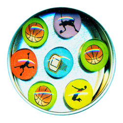 "Basketball Glass Gem Magnet Set - Handmade in our studio, our basketball glass gem magnets start with  tiny drawings which are reproduced, and then sealed under glass. We use super strong ceramic magnets, so they're not only cute, they're functional. Each magnet is about 3/4 inch wide, the tin is 2.75"" wide. Set of 7 in a tin. Made in the USA. 3/4"" wide. Set of 7 in a tin."