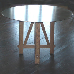"""Cogswell Table With Steel Top - Shown with oak wood base and natural hot rolled steel top. 42"""" diameter x 30""""-32""""h."""