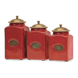 "IMAX - Red Ceramic Canisters - Set of 3 - The vivid red finish of this canister set gives it a bright and cheery look. Each canister has a wood lid and features its own content label. Food safe. Item Dimensions: (6.75-7.25-7.5""h x 3.5""w x 3.5"")"