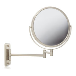 Jerdon JP7808N 8-Inch Two-Sided Swivel Wall Mount Mirror with 8x Magnification - The Jerdon JP7808N 8-Inch Two-Sided Swivel Wall Mount Mirror is used in luxury hotels and spas because of its convenience, sleek look and magnification. This two-sided circular mirror has an 8-inch diameter and features a smooth 360-degree swivel design that provides 1x and 8x magnification options to make sure every detail of your hair and makeup are in place. The extension arm and smooth rotation adjusts to all angles for a dynamic point of view. The JP7808N has a mounting block that measures 2-inches by 5-inches and extends 13.5-inches from the wall and can be easily moved around, while still being firm enough to hold for odd angles. This mirror has an attractive nickel finish that protects against moisture and condensation and is designed to be wall mounted. This item comes complete with mounting hardware. The Jerdon JP7808N 8-Inch Two-Sided Swivel Wall Mount Mirror comes with a 1-year limited warranty that protects against any defects due to faulty material or workmanship. The Jerdon Style company has earned a reputation for excellence in the beauty industry with its broad range of quality cosmetic mirrors (including vanity, lighted and wall mount mirrors), hair dryers and other styling appliances. Since 1977, the Jerdon brand has been a leading provider to the finest homes, hotels, resorts, cruise ships and spas worldwide. The company continues to build its position in the market by both improving its existing line with the latest technology, developing new products and expanding its offerings to meet the growing needs of its customers.