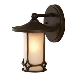 None - Aged Bronze Transitional 1-light Outdoor Wall Sconce - Don't leave guests in the dark when you can light up your entrance with this classic outdoor wall sconce. The etched glass shades creates a welcoming glow to guide visitors up the front steps, while the aged bronze fixture adds style to the exterior.
