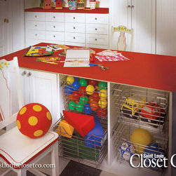 Saint Louis Closet Co. Other Areas to Organize - Saint Louis Closet Co. can make a Place for Everything in your home, including toys, balls, and trucks!  Custom-designed systems that are floor-based are safe for children of all ages - no need to worry about climbers!!  Chrome baskets, cabinets and drawers are the perfect house for all your child's needs.  Give them a colorful Wilsonart Countertop and they'll be busy for hours.  www.stlouisclosetco.com