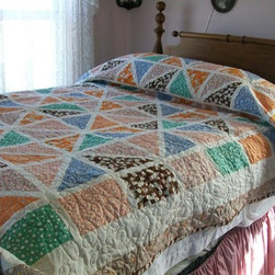 Daisies and Dukes Queen Quilt by Ugly Duckling Studio - Quilts are usually very exuberant in their appearance, and the punchy fabrics on this one are perfect for a fun area of your home. Try using a colorful quilt as a throw on the couch in your family den.