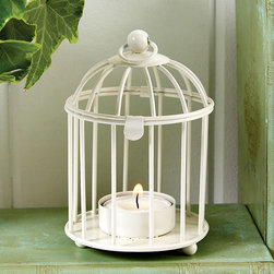 Bird Cage Tealight Holder - A touch romantic, a touch shabby chic but totally sweet and a delightful accessory to adorn tables with at a bridal or baby shower or perhaps in your master bath when you need a bit of candle lit illumination. A painted white iron birdcage houses a single tea light and is completed with a latch and a ring at the top - perhaps for hanging in a grouping for use as a centerpiece. The possibilities are endless with this small but mighty accent piece.