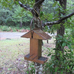 Handmade Solid Copper Birdfeeder - This is a truly unique bird feeder. It's solid copper construction makes it one of the most substantial feeders I've ever seen. I can imagine that it would only look cooler with time as the copper gains its patina.