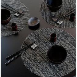 Chilewich - Knit Set of 4 Round Tablemats by Chilewich - Make your tabletop feel all warm and cozy with the Chilewich Knit Set of 4 Round Tablemats. While not usually associated with table linens, the effect of the knitting technique is wonderfully textural. That is coupled with the functionality and ease of maintenance inherenet to all Chilewich woven vinyl placemats. For over a decade, New York based designer Sandy Chilewich has been creating original and innovative vinyl products for the home. Her woven, tufted, molded and spun textiles are available in a range of vibrant and neutral hues that have become synonymous with the Chilewich brand name.