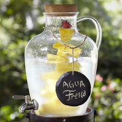 Jug Outdoor Drink Dispenser - I think this drink dispenser jug is begging to serve lemonade on a hot summer's day. I love its vintage looks, and the handle would be useful for transporting the jug back indoors to be refilled.