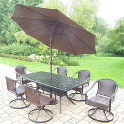 Oakland Living - 9-Pc Rectangular Dining Set - Includes boat shaped table, six swivel chairs, 9 ft. tilt crank umbrella with stand and metal hardware. Lightweight and handcast. Chip and crack resistant. Hardened powder coat. Warranty: One year limited. Made from tubular aluminum, steel, and resin wicker. Black color. Minimal assembly required. Swivel chair: 23.25 in. W x 25.5 in. D x 34 in. H (24 lbs.). Table: 70 in. L x 38 in. W x 29 in. H (75 lbs.). Overall weight: 239 lbs.This dining set will be a beautiful addition to your patio, balcony or outdoor entertainment area. Our swivel sets are perfect for any small space, or to accent a larger space. The Oakland Tuscany Collection combines style and modern designs giving you a rich addition to any outdoor setting. The Oakland Tuscany Collection adds functionality and ease of use. The Oakland Tuscany Collection is perfect for any outdoor patio, back yard or garden.