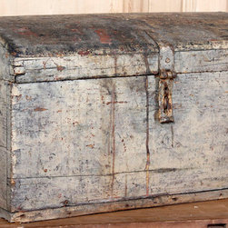 Antique Steamer Trunk - Trunks come in all shapes, sizes and colors. This one's rounded top encouraged its place on the top of the baggage pile to help prevent damage.