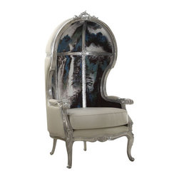 Abstract Balloon Chair - If it ain't Baroque, don't fix it! While this balloon-style chair has a classic rococo frame, it takes mixed media to new heights with an artistic interior and patent leather accents. Find the perfect spot in your space for this extravagant perch.