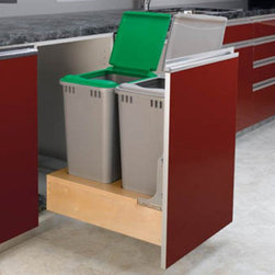 Rev-A-Shelf - Rev-A-Shelf Double Rev-A-Motion Pull Out 50 qt. Trash Can - 4WCBM-2150DM-2 - Shop for Organization and Storage from Hayneedle.com! The Rev-A-Shelf Double Rev-A-Motion Pull-Out 50-Quart Trash Can and its patent-pending Rev-A-Motion Soft Open-Soft Close slide system will ensure that your kitchen stays just as clean as it is in your imagination. The innovative gas spring-assisted Soft-Open allows the unit to open smoothly and the Soft-Close shuts softly even under the heaviest of loads. The unique design allows installation into 1.5-inch 1.625-inch and 1.75-inch face frame sizes as well as frameless constructions. Storing up to 50 quarts or 25 gallons of waste each waste unit has a metallic silver exterior and a dovetail constructed frame for a clean look. A removable wood bin stores bags in the rear compartment. Built-in door-mount brackets and five screws are included for easy installation. Dimensions: 21.375L x 17.25W x 23.1875H inches. About Rev-A-ShelfOriginally a division of Ajax Hardware Rev-A-Shelf was established in 1978 as a family-owned manufacturer of a variety of helpful home products. Rev-A-Shelf offers Lazy Susans kitchen drawer organizers cabinet and pantry pull-outs and functional waste containers. All products consist of polymer wire wood and stainless steel components which will seamlessly complement kitchen appliances and accessories. Rev-A-Shelf aims to revolutionize the way kitchens are organized across the country.