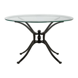 "MYLES 36"" ROUND GLASS COFFEE TABLE WITH IRON BASE - Handcrafted with sleek glass and enduring metal, this 36"" round glass coffee table is crafted for outdoor use. Swooping lines of hand-forged iron twist and turn, merging elegantly into a spectacular metal sculpture that becomes a table base with a delightfully avant garde attitude. A sheer glass tabletop offers the perfect finishing touch."