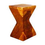 Kammika - Rest Stool 12x12x20 inch H Sust Monkey Pod Wood w Eco Friendly Livos Oak Oil Fin - Our Rest Stool Sustainable Monkey Pod Wood 12 inch x 12 inch x 20 inch height with Eco Friendly, Natural Food-safe Livos Oak Oil Finish is a large piece of Monkey Pod wood carved reminiscent of a wooden chopstick rest. This versatile sturdy functional art piece is solid and reliable as a stool, stand or end table. Craftspeople from the Chiang Mai area in Northern Thailand create these unique pieces with the simplest of tools. Carved from a single piece of sustainable Monkey Pod wood and finished with eco friendly, natural Livos Oak Oil, these functional art pieces are appealing to the viewer from any angle. Each is a Work of Art, Functional Sustainable Monkey Pod Wood Eco Friendly Art! After each Monkey Pod wood (Acacia, Koa, Rain Tree grown for wood carving) piece is kiln dried, carved and sanded, it is rubbed in Livos Oak tone oil that is polished to a water resistant and food safe matte finish. The light and dark portions of wood turn to darker shades of brown over time and the alkaline in the oils creates a honey orange color. There is no oily feel; and cannot bleed into carpets, as it contains natural lacs. We make minimal use of electric hand sanders in the finishing process. Dried in solar and or propane kilns, no chemicals are used in the process, ever. Made from the thick branches of the quick-growing Acacia tree in Thailand - where each branch is cut and carved to order (allowing the tree to continue growing), each eco friendly functional art piece is packaged with cartons from recycled cardboard with no plastic or other fillers. The color and grain of your piece of Nature will be unique, and may include small checks or cracks that occur when the wood is dried. Sizes are approximate. Products could have visible marks from tools used, patches from small repairs, knot holes, natural inclusions or holes. There may be various separations or cracks on your piece when it