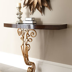 "Maitland-Smith - Maitland-Smith ""Fedora"" Console - An ornate scrolled leg adds sophisticated interest to this wall-mounted console table. Handcrafted of mahogany and scrolled iron. Ebony-finished Zebrano veneer top. Gold-leaf finish on leg. 47""W x 14""D x 34""T. Imported."