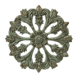 Architectural Wall Medallion - 19.25 diam. in. - It may be hard to reassure your friends that you didn't lift the Architectural Wall Medallion - 19.25 diam. in. out of a Baroque palace. The distressed patina and architectural styling of this medallion gives a opulent look to any room. Perfect for any style, this piece is time worn for maximum appeal.About IMAXWhat began as a small company importing copper flower containers in 1984 by Al and Faye Bulak has developed into one of the top U.S. import companies serving the At Home market today. IMAX now provides home and garden accessories imported from twelve countries around the world, housed in a 500,000 square foot distribution center. Additional sourcing, product development and showroom facilities in the USA, India and China make IMAX a true global source. They're dedicated to providing products designed to meet your needs. This is achieved through a design and product development team that pushes creativity, taste and fashion trends - layering styles, periods, textures, and regions of the world - to create a visually delightful and meaningful environment. At IMAX, they believe style, integrity, and great design can make living easier.