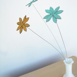 Rustic Wood Flowers by Uncommon Handmade - If you want to invest in faux flowers that will last, these wooden daisies are what you need. They can be cheerful all year long.