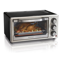 "Hamilton Beach - Six Slice Convection Toaster Oven - This Convection Toaster Oven gives you second oven convenience. Saves time and energy as it reheats 27% faster and uses 74% less energy. Convection cooks more evenly as the fan circulates heated air around food to cook more evenly than a traditional oven. Bake, Convection, Broil and Toast settings. It features a 30 minute timer with auto shutoff and ready bell and removable crumb tray. Fits six slices of bread, a 6 lbs. chicken, a 7 lb. roast or a 9"" pizza. Bake pan and broil rack included."