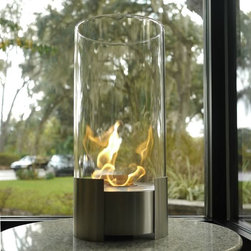 Bluworld Nu-Flame - Caldo Personal Tabletop Ethanol Fireplace - This is certain to be your favorite center piece. Standing over 20� tall this impressive portable tabletop fireplace features a brushed stainless steel base and stunning tempered glass cylinder encasing the flames. Caldo tabletop bio-fireplace is easily moved from room to room when not in use and may be used indoors or out, however do not leave your fireplace outside exposed to the elements after use. Ships with snuffer.  Fuel not included, we recommend using Nu-Flame Bio-Ethanol Fuel.