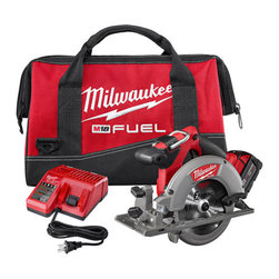 "Milwaukee Electric Tools - Saw Circular M18 Fuel 6-1/2In - The saw's Redlink Plus intelligence ensures optimized performance and protection from overloading, overheating and over-discharging. The 18 v lithium Ion circular saw's guards and shoe are built of cast magnesium to provide a durable, lightweight base. Th  e saw also features an integrated LED light and a rafter hook for convenient storage on the job. Weighs only 8 lbs. 5,000 rpm.  5/8"" arbor size. 50 degrees max bevel capacity. The kit includes (1) M18 Fuel 6-1/2"" circular saw, (1) M18 Redlithium XC 4.0 ex  tended capacity battery pack, (1) M18 & M12 multi-voltage charger, (1) blade, (1) blade wrench and (1) contractor bag.      This item cannot be shipped to APO/FPO addresses.  Please accept our apologies"