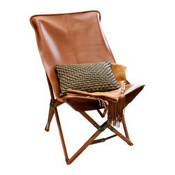 Tripolina Chair, Brown, Leather - La Tripolina, originally designed and made for British military troops in North Africa in the late 1800's, was the inspiration for the classic BKF butterfly chair, steeped in design history. Light weight and fully collapsible, comfortable and stylish. This chair is available in cover materials of weather resistant canvas, handsome and durable leather or cowhide, and in a selection of colors. The frame is available in dark brown, cherry or clear finish. We suggest to call or email to see what we have in stock before ordering.