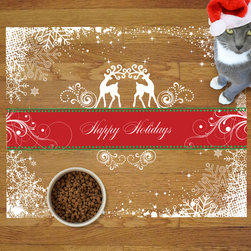 Sniff It Out Pet Mats - Holiday Reindeer Pet Food Mat, Large - The snowflakes around the border might call to mind frost on a windowpane, but you and your pet will be warmed by the joyous greetings from the heraldic reindeer. An elegant design that will look beautiful on your medium or dark floor. Clear vinyl designer mat uniquely designed to resemble beautiful art painted directly onto your floor. The smoothness of the vinyl allows for easy cleanup and lays perfectly flat. Sniff It Out Pet Mats make great gifts and will be a conversation piece that your friends and family won't stop talking about. Happy Holidays, indeed! Made in the USA.