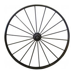Wire Wagon Wheel - Vintage wagon wheel. Fairly large made from metal.