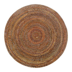 Calaisio - Round, Rattan Placemat - These hand woven placemats are created from a water vine that only grows in the mountainous areas of the South Pacific. Once reaped it grows back quickly, leaving no damage in these ecologically sensitive forests. They can be easily rinsed off because of the durability of the material. Each piece has a card attached, signed by the artisan that created it. It also lists the time it took for he or she to weave.