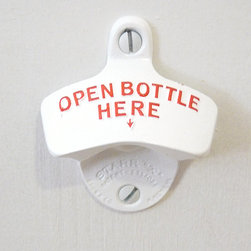Wall-Mounted Bottle Opener - Whether your drink of choice is a Gus Meyer Lemon soda or a chilled Heineken, it's easy to pop off the top with this classic bottle opener. These wall-mounted bottle openers have been made by the same family-owned business for 80 years — a practical accessory for the kitchen.
