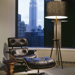 """Herman Miller � - Eames  Walnut Stool - Abstract chess pieces. Small tables. Low seats. The beauty of the Eames Walnut Stools is that they are all of these, quite surprising when you consider that their original purpose was to adorn a specific lobby in a specific structure  the 1960 Time-Life Building in New York City. Several pieces of solid walnut, turned to create interesting shapes, laminated and pinned together, give these stools a satisfying heft. The Design - Ray Eames drew on her training as a sculptor to design a new kind of occasional piece for the lobby of the Time-Life Building in New York City. Eames walnut stools became her favorite seats and were liberally scattered about the Charles and Ray Eames home in Pacific Palisades. -A museum curator once ordered two of these stools for his son and daughter. """"Graduation gifts?"""" he was asked. """"No,"""" he said, """"the kids are only five and three. But I want them to have the experience of growing up with something truly good that they can keep all their lives."""" . . Features at a Glance:  -Interactive Art  -Beautiful solid walnut. -Available in three distinctively sculpted profiles. -Designed for strategic placement in living areas, lounges, offices, and lobbies.. -Smart Design  -Top and bottom surfaces are both concave. . -Can be used either side up. -Top diameter is 13 inches.. -Bottom diameter is 11 inches. -Functional Sculpture  -Design reminiscent of a chess piece. -Compact in size yet sturdy. -Functions as a stool, end table, display surface, or decorative accent Dimensions:  -Height: 15"""". -Top Diameter: 13.25"""". -Bottom Diameter: 11"""". Why Buy From Us? . -Wayfair backs a 1-Year Herman Miller Manufacturer Warranty. Should you experience any problems with your Eames Walnut Stool, Herman Miller will cover the cost of fixing it for you within this time period.. -Also, should you discover shortly after receiving your Eames Walnut Stool that parts are either damaged or missing, please call us immediately, and we will b"""