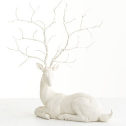 Festive Ornamental Deer - This cream-colored deer has the perfect antlers for those extra ornaments. I would reserve this for the most sentimental ones I have collected.