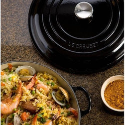 Le Creuset - Le Creuset Matte Black Signature Braiser - 1.5 qt. - LS2532-2220 - Shop for Braisers & Paella Pans from Hayneedle.com! The Le Creuset Matte Black Signature Braiser - 1.5 qt. is the perfect size for side-dishes soups stews and more. Its heavy-duty cast iron exterior is coated with matte black enamel with a textured interior that helps prevent burning and sticking. A sturdy no-slide lid is included and helps to ensure your food remains moist and tender while keeping steam and boil-overs to a minimum. This handsome braiser is over rated up to 500 F and works equally well on all stove tops (including gas electric and induction ranges). Piece is dishwasher safe and weights a light but resilient 5 lbs.About Le Creuset of America Inc.From its cast iron cookware to its teakettles and mugs Le Creuset is a global standard of inimitable color and quality. Founded in 1925 in the northern French town of Fresnoy-Le-Grand Le Creuset still produces enameled cast iron in its original foundry. Its signature color Flame was modeled after the intense orange hue of molten cast iron within a cauldron (or creuset in French) and has been a Le Creuset bestseller from the company's first year to the present day.Though best known for its vibrantly colored cookware and original inventions such as the Dutch oven Le Creuset has also forged a name as a creator of stoneware mugs and enamel-coated stainless steel teakettles. The style and performance of Le Creuset's Cafe Collection and tea accessories are rooted in classic French cookware: bold colors cylindrical loop handles unmatched thermal resistance and heat distribution and of course the iconic Le Creuset three-ring accent. Through its consistent qualities of authenticity originality and innovation Le Creuset maintains a connection to both heritage and modernity.