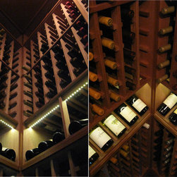 LED display lighting by Kessick Wine Cellars - LED lighting is perfect for a wine cellar because: They can be dimmed, there is a wide range of color options (shown 3500K), Very low heat output, Does not emit UV light rays that can damage wine, very long running time (10 years+) and it uses a very small amount of energy. Kessick factory installs them in their wine racks.