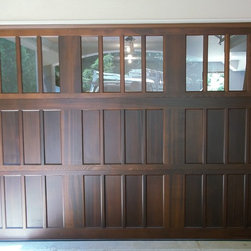 Various Installs - Clopay Semi-Custom Series carriage style wood door. Dark Oak Factory Stain 009.  Installed in Highland Park by Overhead Garage Door, Inc.  1-888-459-3720.  10 x 7 Odd size.