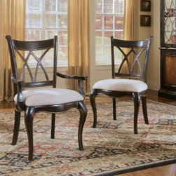 Hooker Furniture Preston Ridge Oval Back Dining Arm Chairs - Set of 2 - Classic design and quality construction make the Preston Ridge Oval Back Dining Arm Chairs - Set of 2 an easy choice for dining room elegance. This elegant pair features an open back with oval detailing and shapely legs for a traditional style with some detailed flair. A cherry rub-through finish completes the look, making it ideal for formal dining decors.Composed of hardwood solids and mahogany and ash veneers, this pair is not only stunning, it's also well-crafted and durable to outlast generations of dinner parties, holidays, and cherished gatherings around your dining room table. Carefully chosen details such as an upholstered seat option and subtle gold highlighting ensure its timeless style.Not available for sale in, or delivery to, the state of California.About Hooker Furniture CorporationFor 83 years, Hooker Furniture Corporation has produced high-quality, innovative home furnishings that seamlessly combine function and elegance. Today, Hooker is one of the nation's premier manufacturers and importers of furniture and seeks to enrich the lives of customers with beautiful, trouble-free home furnishings. The Martinsville, Virginia, based company specializes in lifestyle driven furnishings like entertainment centers, home office furniture, accent tables, and chairs.Construction of Hooker FurnitureHooker Furniture chooses solid woods and select wood veneers over wood frames to construct their high-quality pieces. By using wood veneer, pieces can be given a decorative look that can't be achieved with the use of solid wood alone. The veneers add beautiful accents of color and design to the pieces, and are placed over engineered wood product for strength. All Hooker wood veneers are made from renewable resources and are located primarily on the flat surfaces of the furniture, such as the case tops and sides.Each Hooker furniture piece is finished using up to 30 different steps, including 13 steps of hand-sanding and accenting. Physical distressing is done by hand. Pieces receive two to three coats of solid lacquer to create extra depth and add durability to the finish. Each case frame is assembled using strong mortise-and-tenon joints, which are then reinforced by mechanical fasteners and glue. On most designs, end panels extend to the floor to add strength and stability. Panel-style furniture features strong panel and frame construction to help avoid warping.Your Hooker furniture features finished case interiors to eliminate unsightly raw wood and to help protect items you may store inside drawers or cabinets. Drawer parts are given a urethane or lacquer finish to create smooth action and durability. All drawers use dovetails, either English or French, for years of problem-free use. Drawer bottoms are constructed from plywood and attached to the plywood drawer sides via the use of hot glue and/or wood glue blocks. Most drawers are full width, depth, and height to provide the maximum amount of storage space.