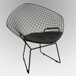 Baxton Studio Bertoia Style Wire Lounge Accent Chair - The Baxton Studios Bertoia Style Wire Lounge Accent Chair isn't just a chair - it's a work of art. This replica of sculptor and designer Harry Bertoia's 1952 diamond wire chair allows you to incorporate the artist's stylish geometric flair into any room in your home. Crafted from wire mesh and welded chrome-plated steel rods that won't rust or chip this chair is sturdy and durable. The leatherette seat pad adds comfort while the chair's legs feature plastic non-slip guards to protect the chair and your floors. Choose from black or chrome finish to suit your decor. Dimensions: Overall: 33.25W x 25D x 30H inches Seat cushion: 18W x 20D inches Seat height: 16.5H inches