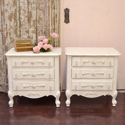 Gorgeous Shabby White Nightstands with 3 Drawers - What a stunning pair of nightstands! Features three drawers with rose appliques and clear, glass knobs decorating the face. Lovely curvy feet. Great for any shabby chic style bedroom. See photos.